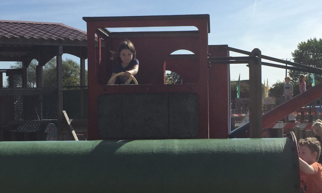 Driving a tractor in the playground at Marsh Farm