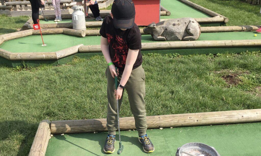 Playing golf at Marsh Farm