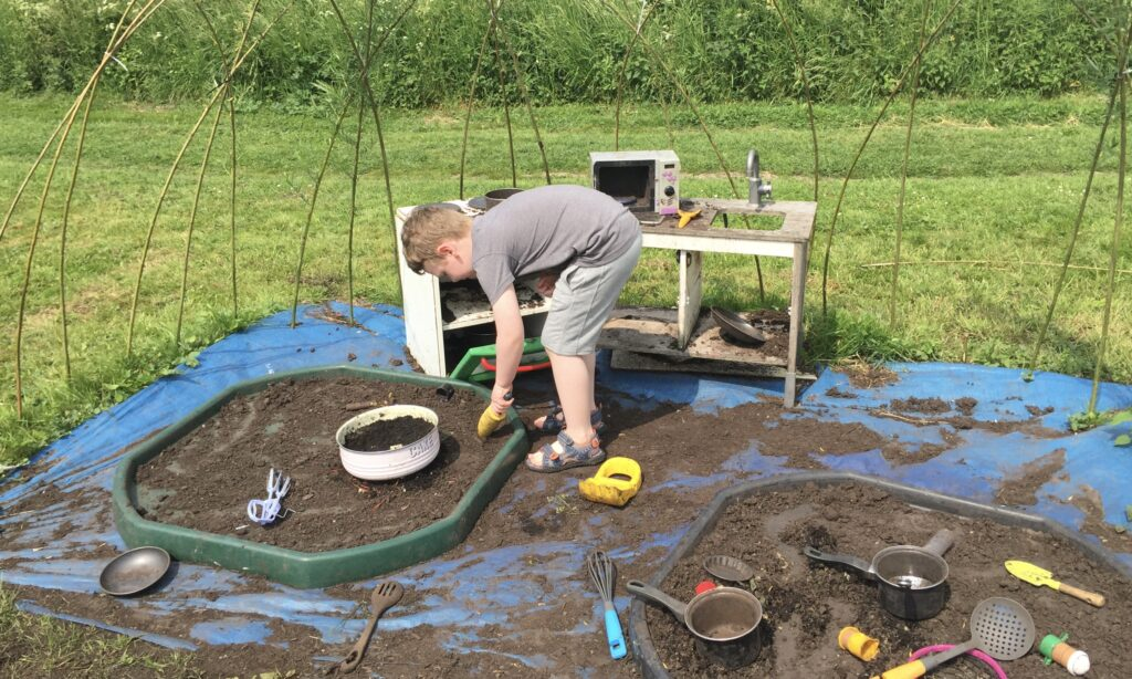 Playing in the mud kitchen at natural foundations