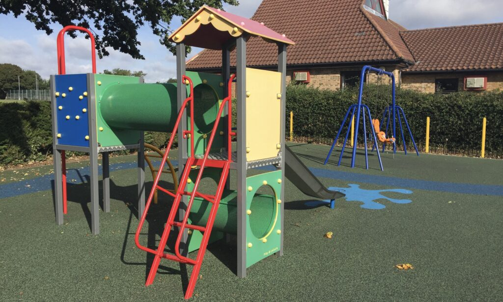 Toddler climbing from and swings at great Baddow recreation ground