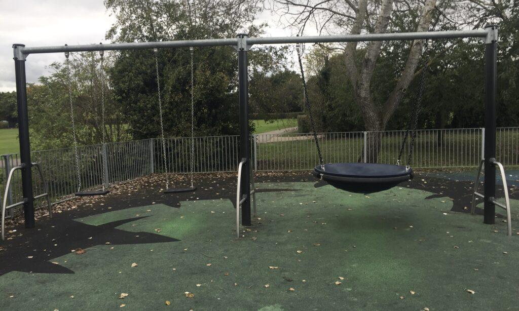 The older children's swings at Chelmer Village Green